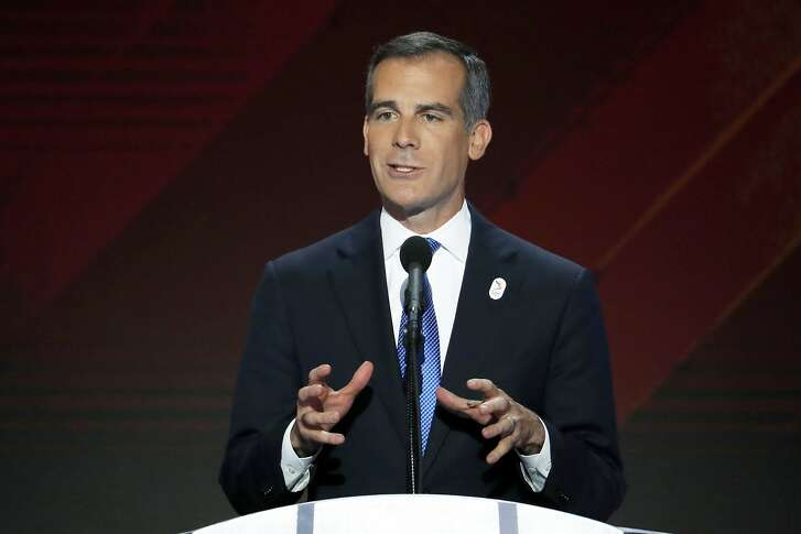 FILE - In this Thursday, July 28, 2016 file photo, Los Angeles Mayor Eric Garcetti speaks during the final day of the Democratic National Convention in Philadelphia. With 10 months before the vote in the race for the 2024 Summer Games, bid leaders from Los Angeles, Paris and Budapest, Hungary, have traveled to Doha, Monday Nov. 14, 2016, to pitch their case to the general assembly of the Association of National Olympic Committees. The Los Angeles presentation, which includes Mayor Eric Garcetti, a Democrat, is likely to deal head-on with the U.S. election result and seek to reassure Olympic officials that the bid represents openness, diversity and inclusiveness. (AP Photo/J. Scott Applewhite, File)
