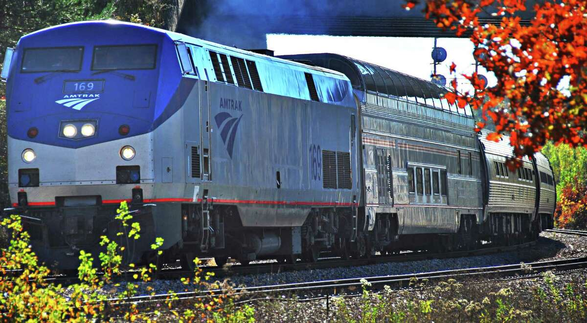 """Times Union staff photo by John Carl D'Annibale: Amtrak's """"Adirondack"""" train with """"Great Dome"""" car (just behind engine) leaves the Saratoga Springs station Thursday afternoon October 25, 2007. Beginning today Amtrak passengers traveling between New York City and Montreal will have the opportunity to enjoy the view from this car. FOR ANDERSON STORY"""