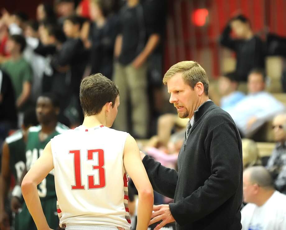 Kingwood Park boys basketball team visited Memorial High School for a game, 12-7-12.  Memorial won the game, 49-35.  Memorial's varsity boys basketball coach Dave Lay gives instructions to Blake Berry (13) during a time out. Photo: Eddy Matchette, Freelance / Freelance