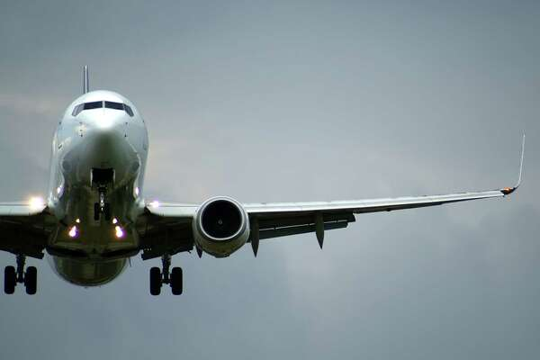 Close up of the plane;  GENERIC AIRPLANE TAKING OFF; AIRPLANE LANDING GEAR DOWN