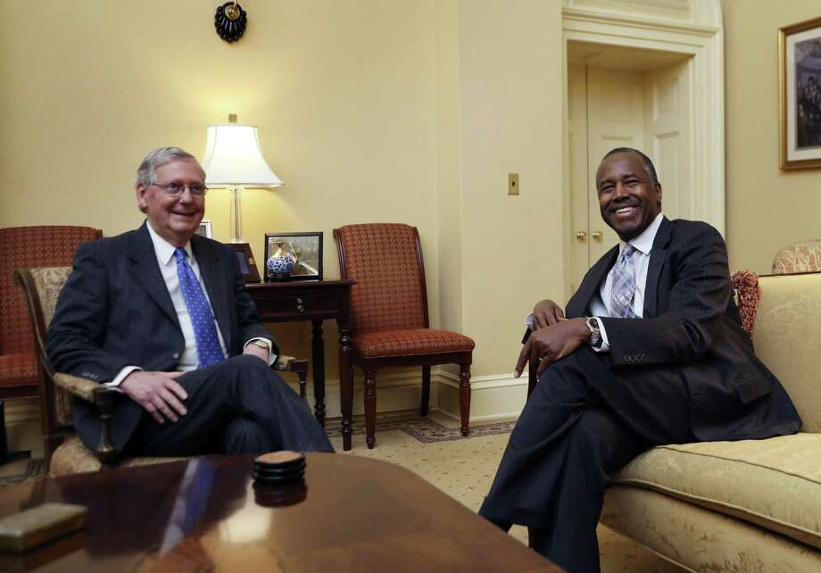 Senate Majority Leader Mitch McConnell (left) meets with Ben Carson, HUD secretary nominee, on Capitol Hill. A reader defends Carson, who has no experience in government. Photo: Manuel Balce Ceneta /Associated Press / Copyright 2016 The Associated Press. All rights reserved.