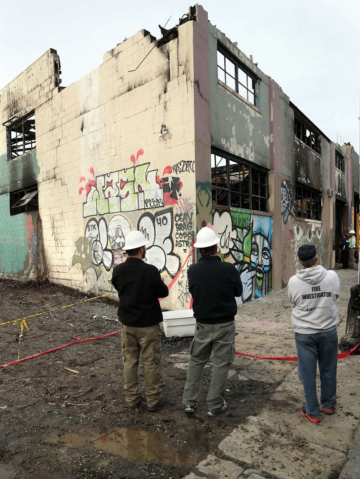 Investigators visit the scene of the deadly Ghost Ship warehouse fire in Oakland, Calif., on Monday, December 12, 2016.