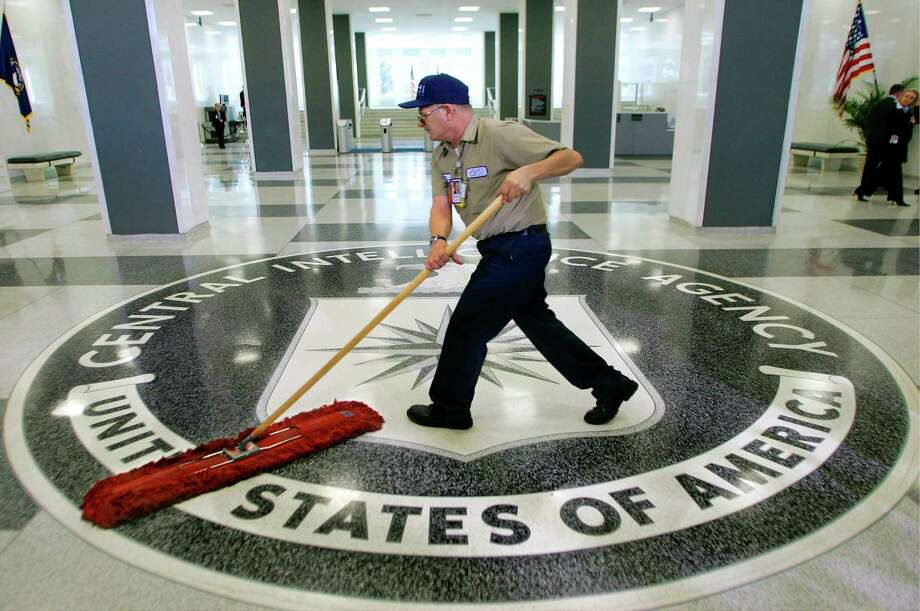 A workman slides a dustmop over the floor at the Central Intelligence Agency headquarters in Langley, Va. (AP Photo/J. Scott Applewhite) Photo: J. Scott Applewhite, STF / Copyright 2016 The Associated Press. All rights reserved.