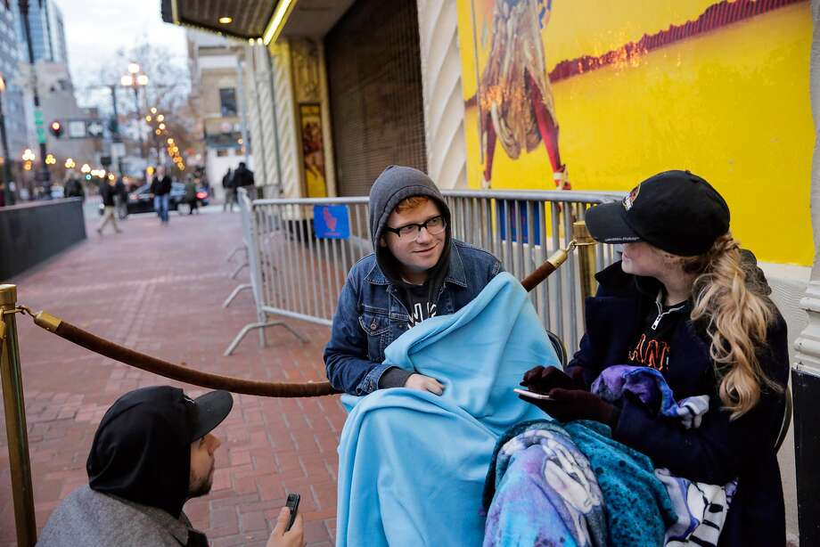 Zachary Dunnington (left), Reid Commack and Elizabeth Bowman , who have been camped out overnight, wait for Hamilton tickets to go on sale. They are the first people in line to get tickets Photo: Gabrielle Lurie, The Chronicle