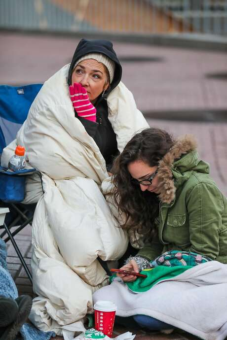 """Jennifer Rasmussen (left) and daughter Madison Rasmussen, who camped out overnight, wait for """"Hamilton"""" tickets to go on sale. Photo: Gabrielle Lurie, The Chronicle"""