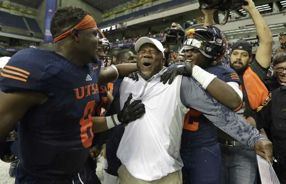 UTSA coach Frank Wilson and his players celebrate their win over Charlotte on Nov. 26, 2016, in San Antonio. The Roadrunners won 33-14, making them bowl eligible for the first time in the history of the football program. Photo: Eric Gay /Associated Press / Copyright 2016 The Associated Press. All rights reserved.