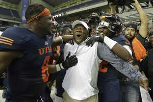 UTSA coach Frank Wilson and his players celebrate their win over Charlotte on Nov. 26, 2016, in San Antonio. The Roadrunners won 33-14, making them bowl eligible for the first time in the history of the football program.