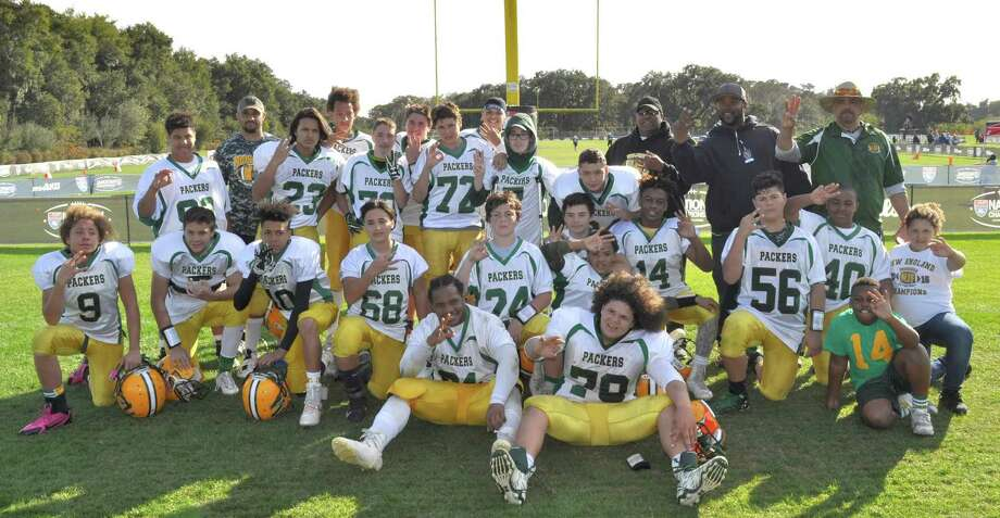 The Norwalk Packers U-13 football team pose for a team photo after winning the third-place game at the 2016 American Youth Football National Championship tournament last week. Photo: Contributed Photo / Hearst Connecticut Media / Norwalk Hour