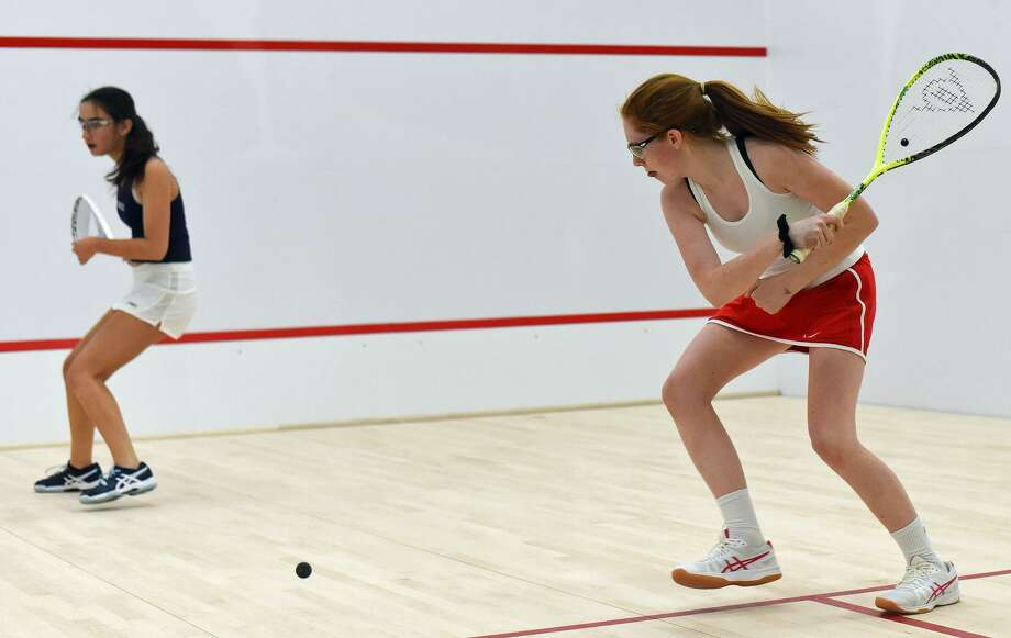 Greens Farms Academy's Clare Foley returns a shot during a squash match against Staples last Friday. The Dragons opened their new facility with a match against Brunswick the day before. Photo: Contributed / Photo