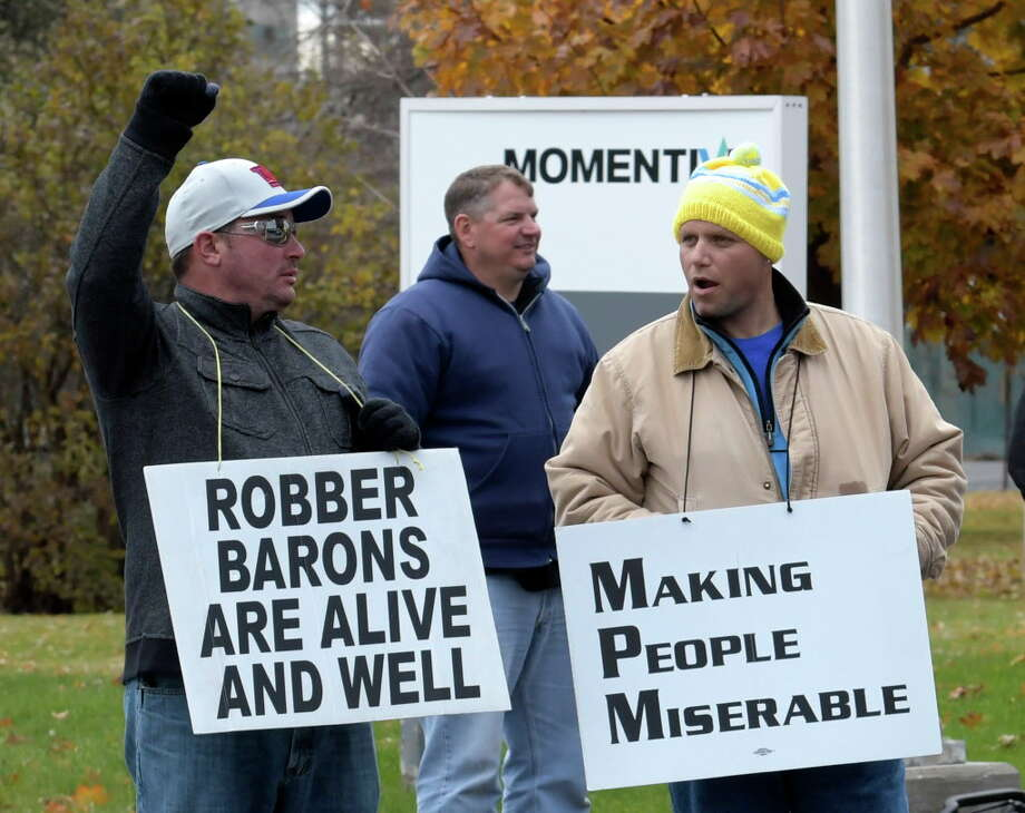 Workers show their union pride by carrying signs with their feelings Wednesday Nov. 16, 2016 at the Momentive Plant in Waterford, N.Y. (Skip Dickstein/Times Union) Photo: SKIP DICKSTEIN / 20038842A