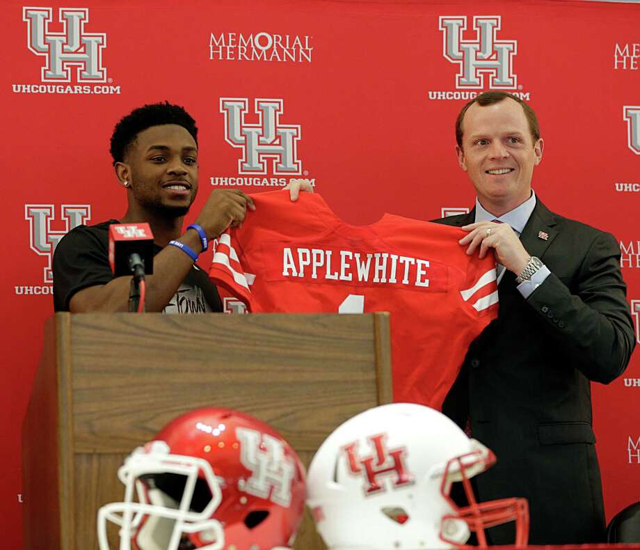 University of Houston quarterback Greg Ward Jr., left, who has worked closely with Major Applewhite for the last two seasons, was given the honor of introducing the new Cougars head coach Monday. Photo: James Nielsen, Staff / © 2016  Houston Chronicle