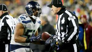 GREEN BAY, WI - DECEMBER 11:  Bobby Wagner #54 of the Seattle Seahawks complains to side judge Alan Eck in the third quarter against the Green Bay Packers at Lambeau Field on December 11, 2016 in Green Bay, Wisconsin. (Photo by Dylan Buell/Getty Images)