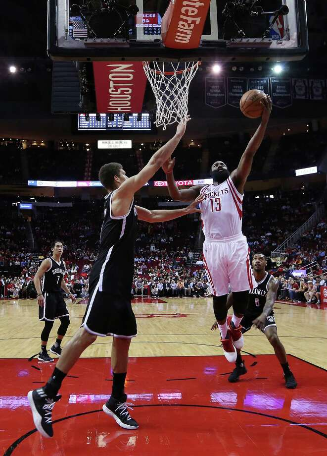 Houston Rockets guard James Harden (13) shoots past Brooklyn Nets center Brook Lopez (11) during the Rockets game against the Brooklyn Nets, Monday, Dec. 12, 2016, in Houston. Photo: Houston Chronicle / © 2016 Houston Chronicle