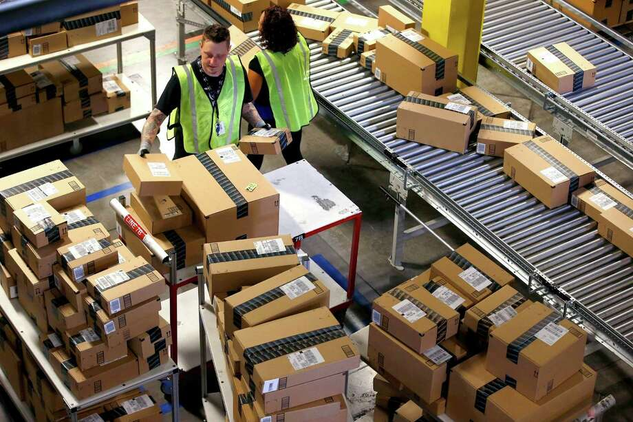 "Amazon.com employees organize outbound packages on a ""Cyber Monday"" in Phoenix.  Photo: Ross D. Franklin, STF / Copyright 2016 The Associated Press. All rights reserved."
