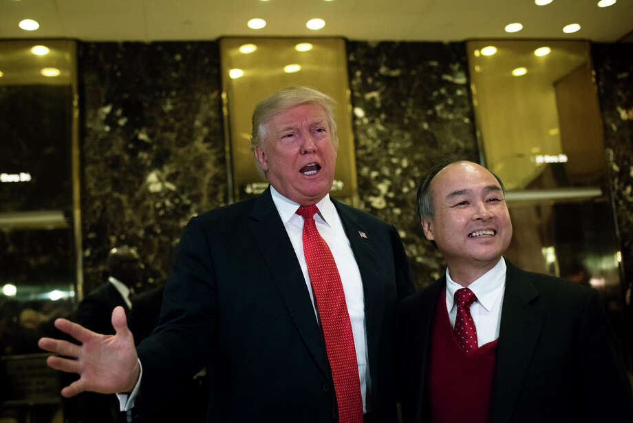 President-elect Donald Trump met with Masayoshi Son, the founder and chief executive of SoftBank Group, last week in New York's Trump Tower.  Photo: HILARY SWIFT, STR / NYTNS