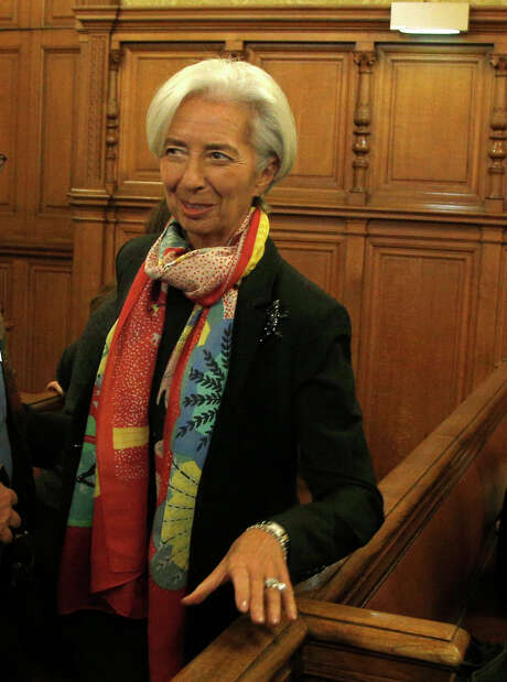 International Monetary Fund chief Christine Lagarde arrives at the special Paris court, France, Monday, Dec. 12, 2016. Lagarde is due to appear in a special court Monday when the trial opens in the case which dates to her time as French finance minister in 2008. The trial is due to last until Dec. 20. (AP Photo/Thibault Camus) Photo: Thibault Camus, STR / Copyright 2016 The Associated Press. All rights reserved.