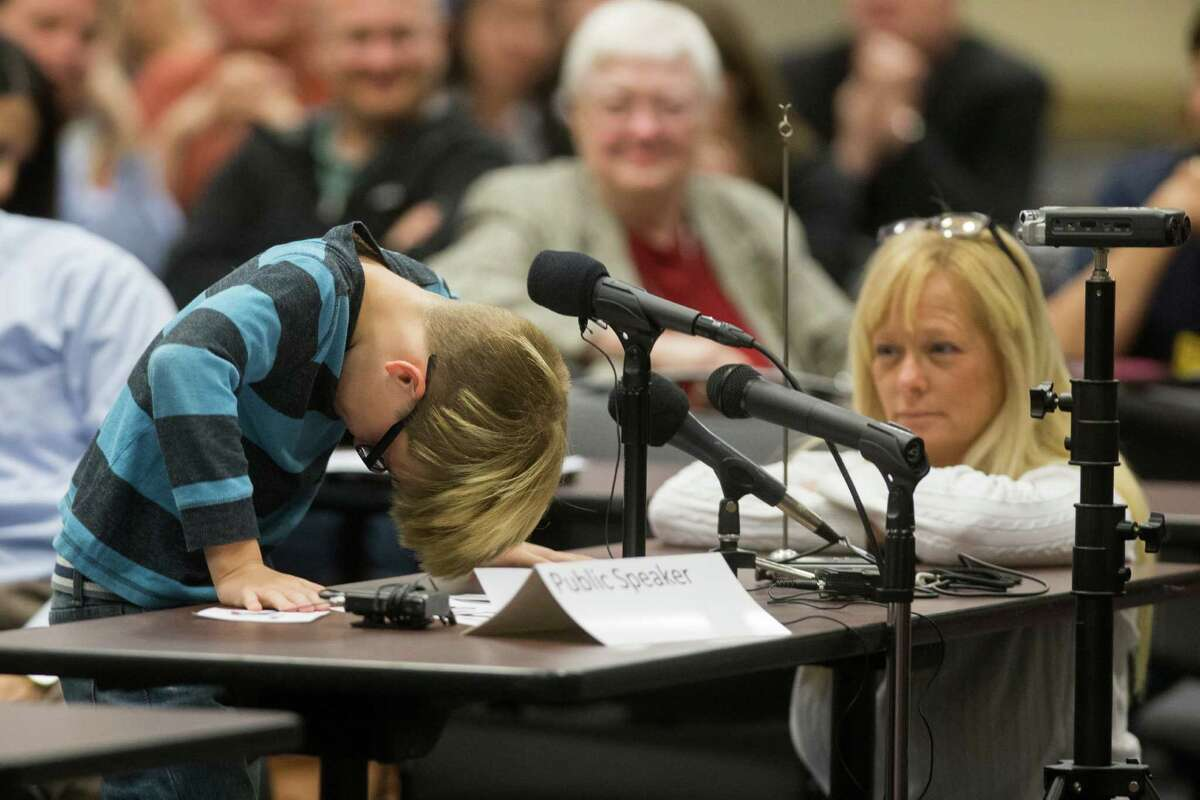 Chris Crowley, 10, talks about issues at his school with support from his mother, Camilyn Marceaux, at a hearing on special education in Houston on Monday.