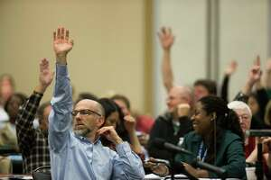 Parents of children with disabilities  who are paying for supportive services outside of the school system raise their hands during a hearing with the representatives from the U.S. Department of Education's Office of Special Education and Rehabilitative Services (OSERS) and the Texas Education Agency (TEA), Monday, Dec. 12, 2016, in Houston. ( Marie D. De Jesus / Houston Chronicle )