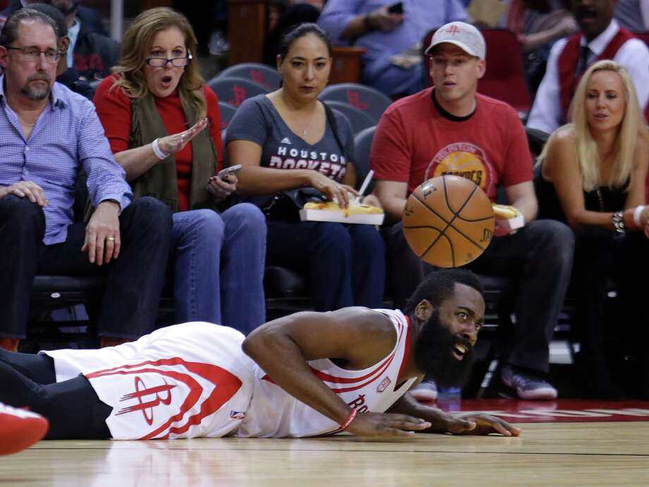 James Harden looks for a call after taking a spill Monday night. Photo: Mark Mulligan, Staff / © 2016 Houston Chronicle