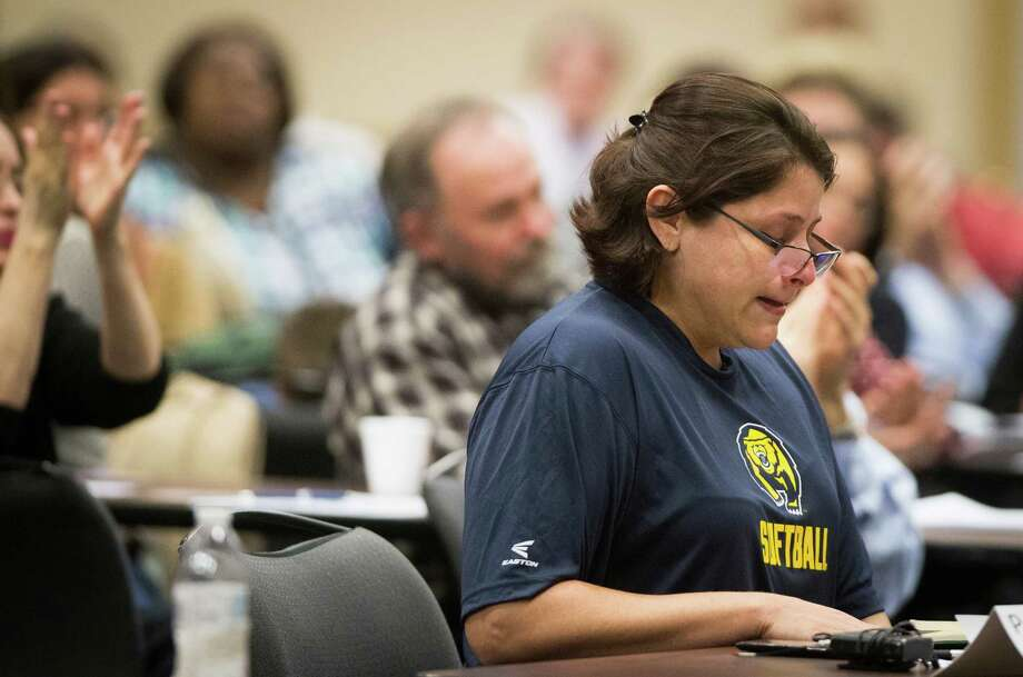 Eva Flores becomes emotional as she speaks about having to provide outside support for their child who suffers from Asperger syndrome, Monday, Dec. 12, 2016, in Houston. Flores is one of 46 parents and school officials who has signed up to speak to the representatives from the U.S. Department of Education's Office of Special Education and Rehabilitative Services (OSERS) and the Texas Education Agency (TEA) about special education. Photo: Marie D. De Jesus, Houston Chronicle / © 2016 Houston Chronicle