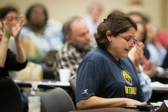 Eva Flores becomes emotional as she speaks about having to provide outside support for their child who suffers from Asperger syndrome, Monday, Dec. 12, 2016, in Houston. Flores is one of 46 parents and school officials who has signed up to speak to the representatives from the U.S. Department of Education's Office of Special Education and Rehabilitative Services (OSERS) and the Texas Education Agency (TEA) about special education.