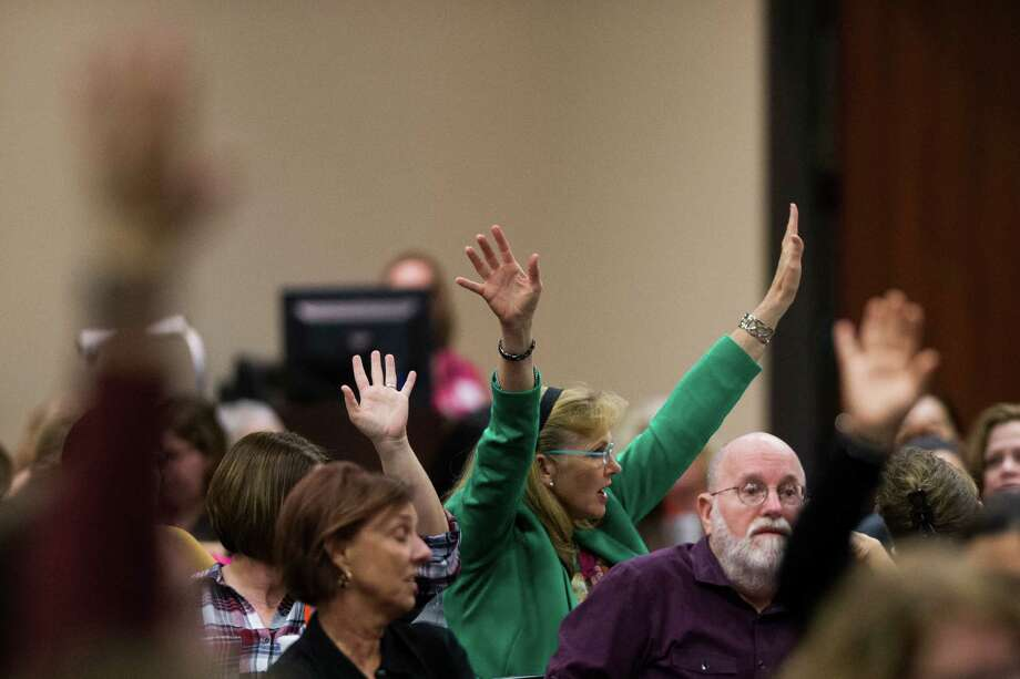 Parents of children with disabilities  who are paying for supportive services outside of the school system raise their hands during a hearing with the representatives from the U.S. Department of Education's Office of Special Education and Rehabilitative Services (OSERS) and the Texas Education Agency (TEA), Monday, Dec. 12, 2016, in Houston. Photo: Marie D. De Jesus, Houston Chronicle / © 2016 Houston Chronicle