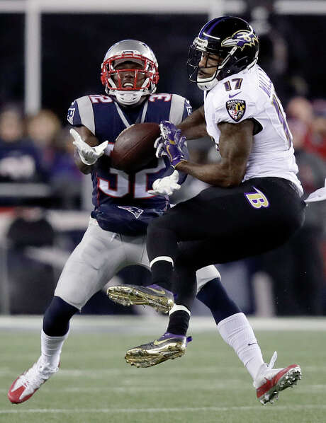 The Patriots' Devin McCourty (32) intercepts a pass intended for the Ravens' Mike Wallace during the first half Monday night. Photo: Charles Krupa, STF / Copyright 2016 The Associated Press. All rights reserved.