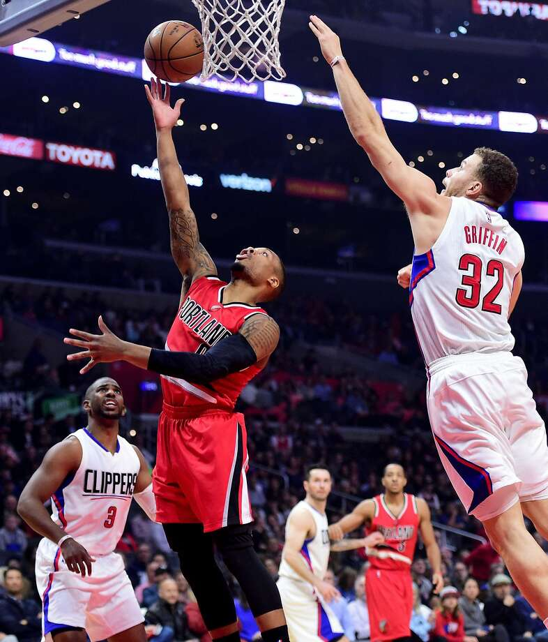 The Clippers' Blake Griffin leaps to block a layup attempt by the Trail Blazers' Damian Lillard. Griffin also scored 26 points and grabbed 12 rebounds in Los Angeles' victory. Photo: Harry How, Getty Images