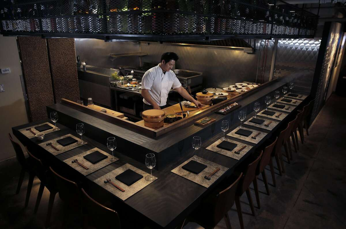Owner/chef, Min Yong Choe, prepares items served at Sushi Hon in San Francisco, Calif., on Monday, December 12, 2016. Sushi Hon is a reasonably priced omakase sushi restaurant that also has a large a la carte menu