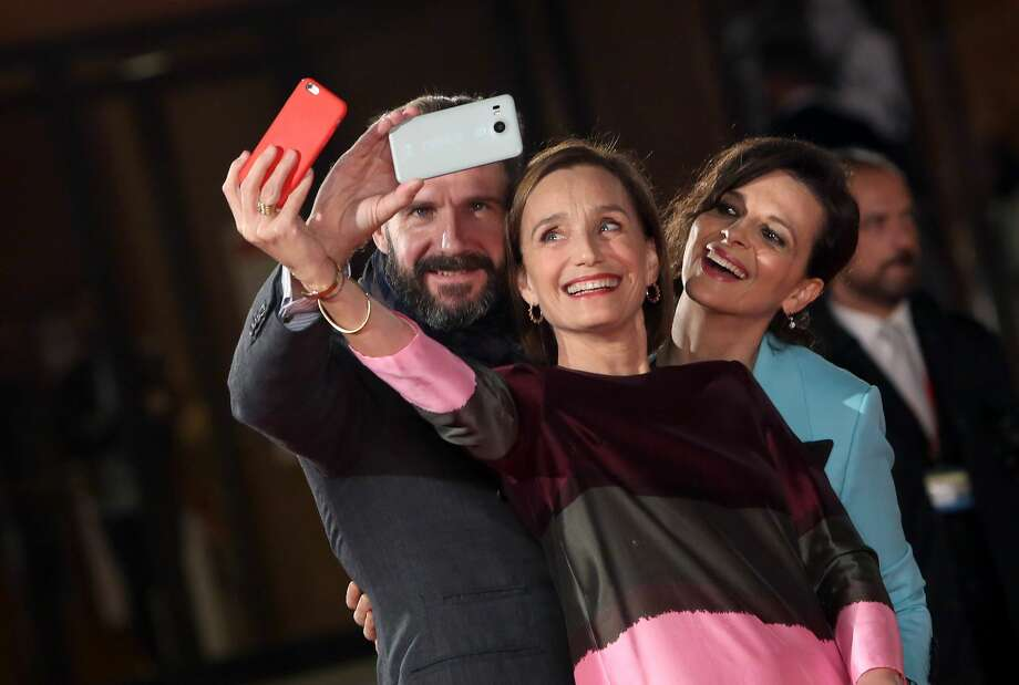 ROME, ITALY - OCTOBER 22:  Kristin Scott Thomas, Ralph Fiennes and Juliette Binoche walk a red carpet for 'The English Patient - Il Paziente Inglese' during the 11th Rome Film Festival at Auditorium Parco Della Musica on October 22, 2016 in Rome, Italy.  (Photo by Elisabetta A. Villa/WireImage) Photo: Elisabetta A. Villa/WireImage