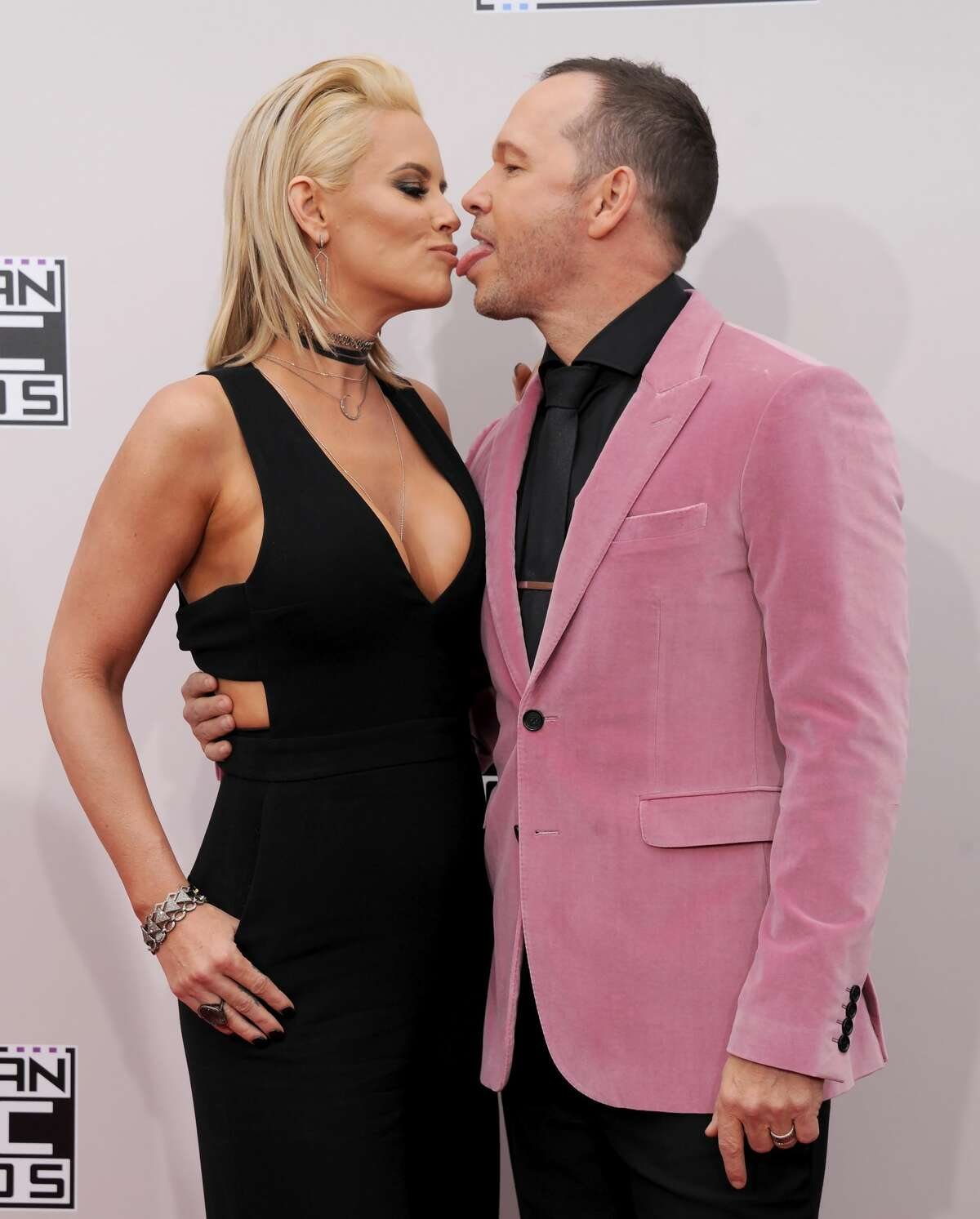 Jenny McCarthy and Donnie Wahlberg arrive at the 2016 American Music Awards at Microsoft Theater on November 20, 2016 in Los Angeles, California.