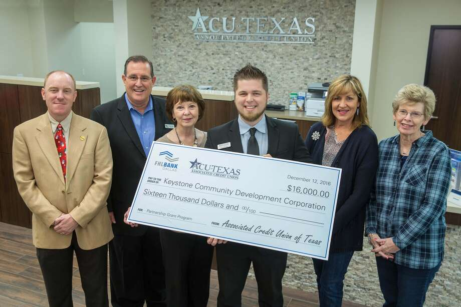 Dignitaries from the city of Deer Park join representatives from the Keystone Community Development Corp., Associated Credit Union of Texas and the Federal Home Loan Bank of Dallas for the presentation of a $16,000 Partnership Grant Program award on Monday, December 12, 2016. The funds will be used to cover costs related to Keystone CDC's homebuyer education program. Photo provided by the Federal Home Loan Bank of Dallas.