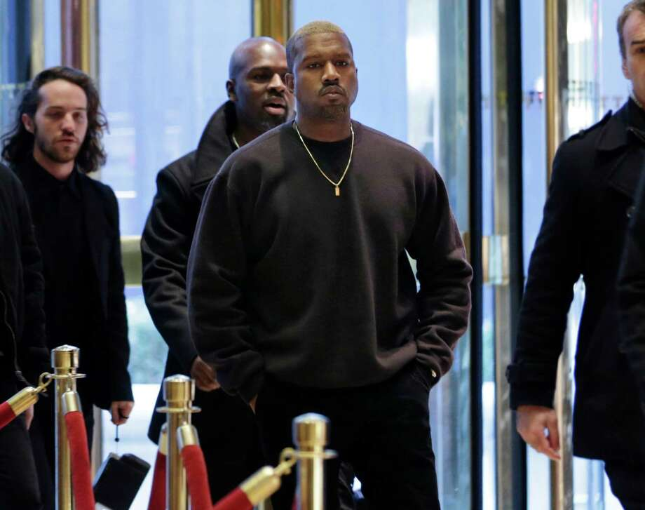 Kanye West enters Trump Tower in New York, Tuesday, Dec. 13, 2016. Photo: Seth Wenig, AP / Copyright 2016 The Associated Press. All rights reserved.