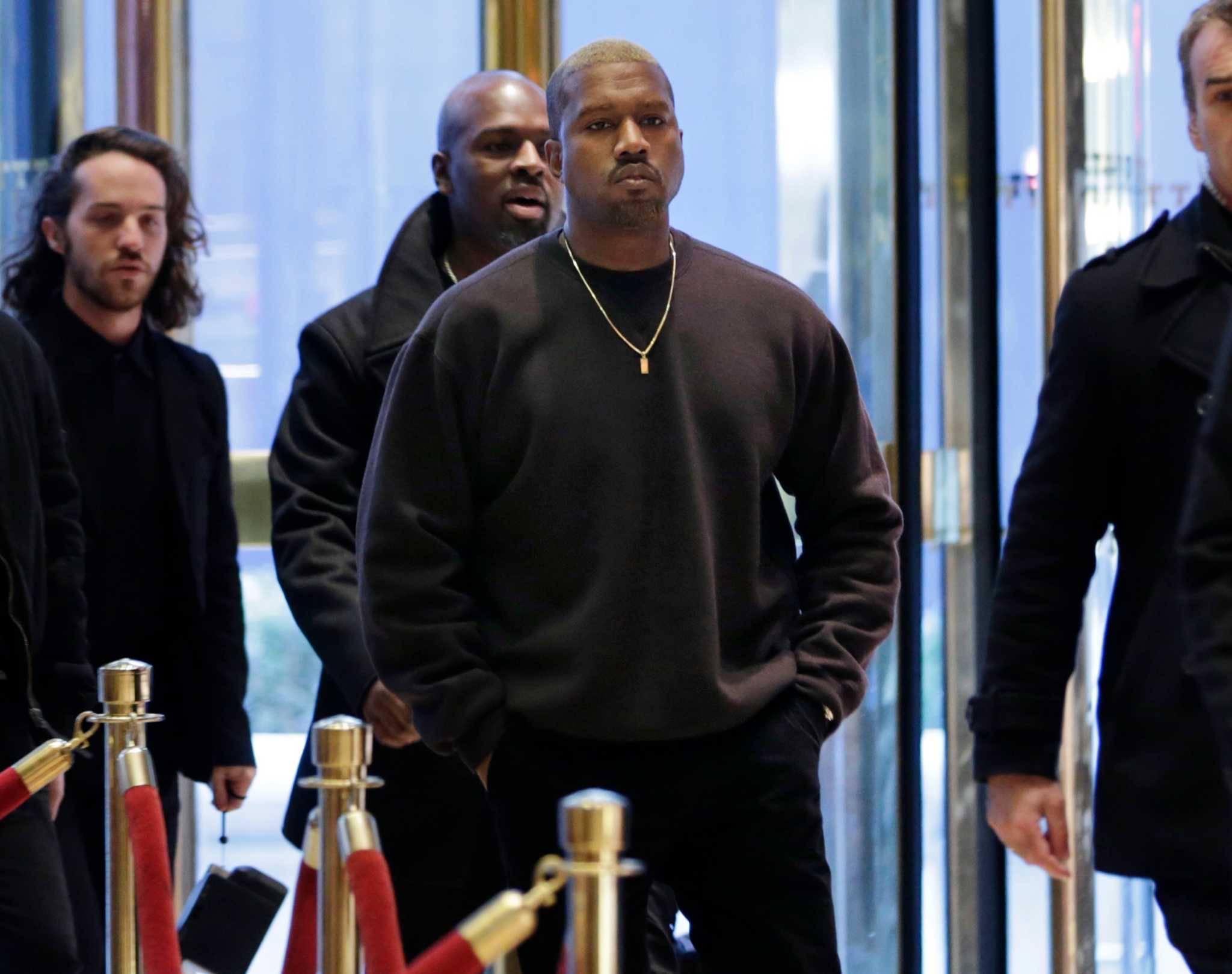 Kanye West's embrace of a black Trump supporter not well-received