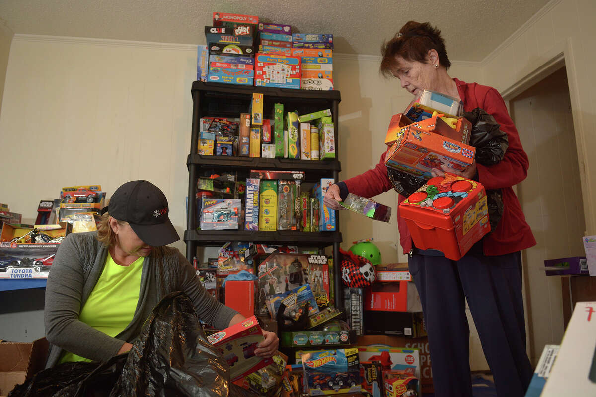 Leigh Ann Blount, left, of Cypress, and Mary McCoy, of Tomball, sort toys at their Tomball Emergency Assistance Ministries (TEAM) toy headquarters in Tomball on Dec. 12, 2016. (Photo by Jerry Baker/Freelance)