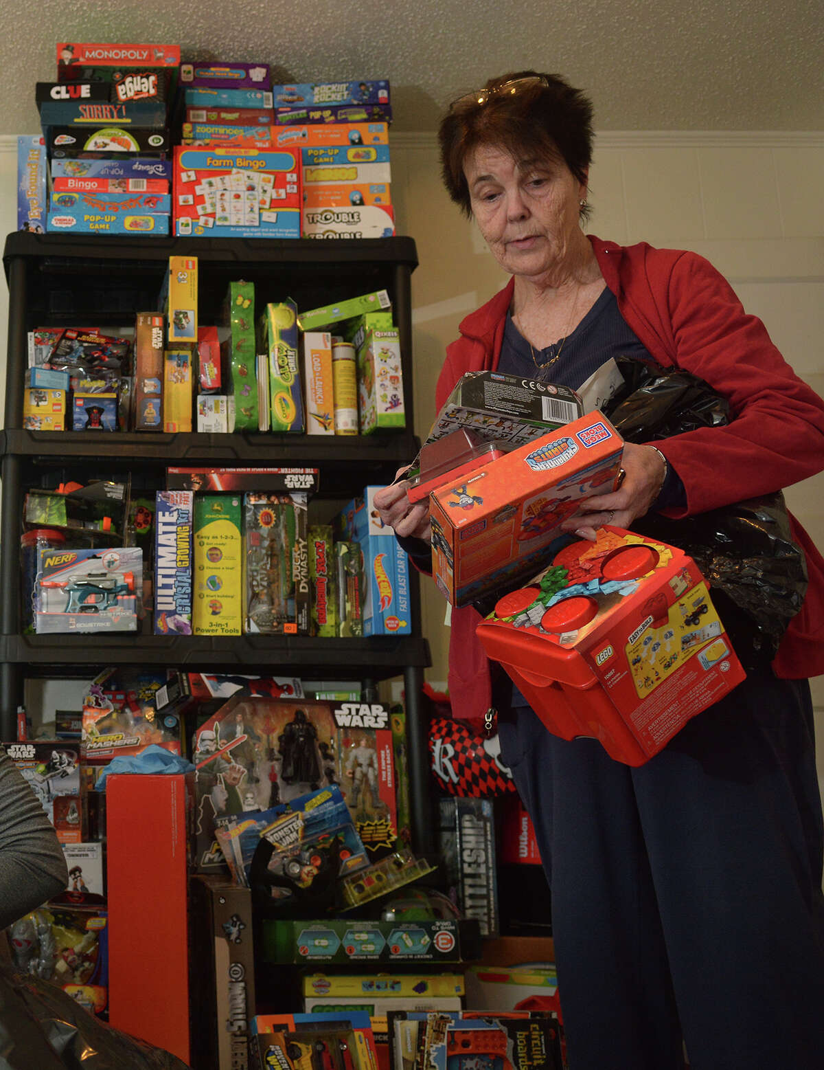 Mary McCoy sorts toys at the Tomball Emergency Assistance Ministries (TEAM) toy headquarters in Tomball on Dec. 12, 2016. (Photo by Jerry Baker/Freelance)