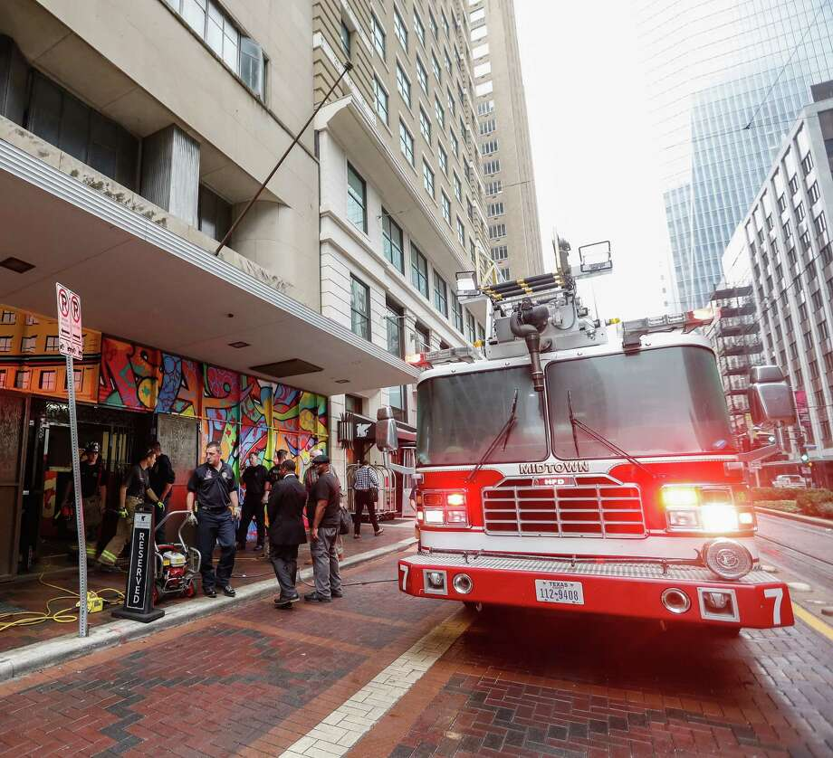 Houston firefighters work the scene of a one alarm fire in the 800 block of Main Street downtown, Tuesday, Dec 13, 2016. No injuries were reported. Photo: Karen Warren / Houston Chronicle