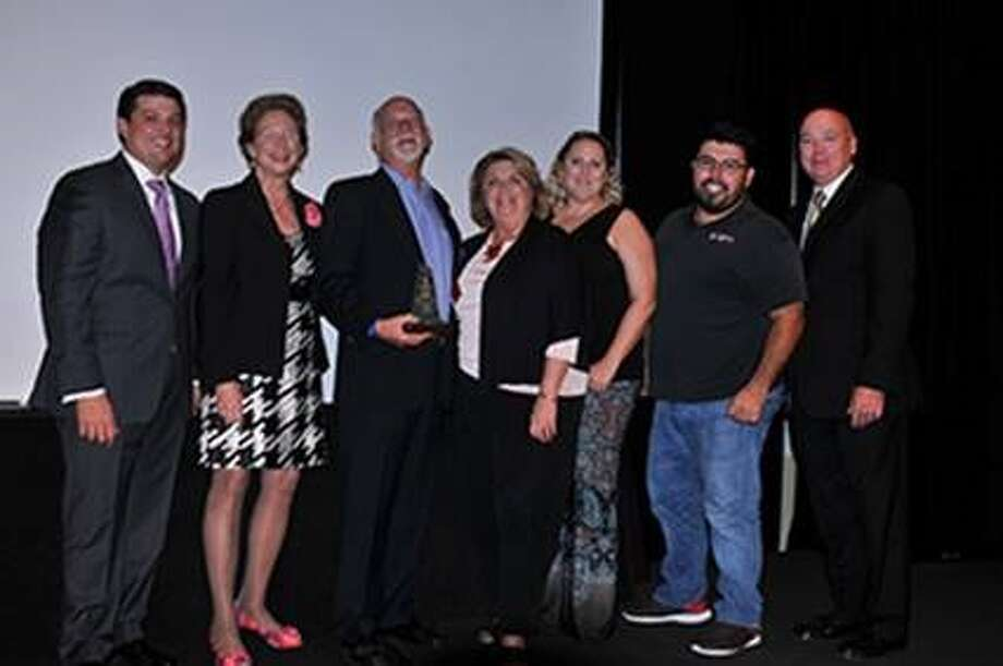 Minuteman Press  was honored as the Small Business of the Year by Lone State College's Small Busines Development Center. Photo: Submitted