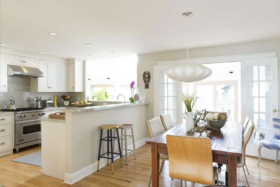A rustic table anchors the open kitchen and dining area. Photo: Vivian Johnson, Special To The Chronicle