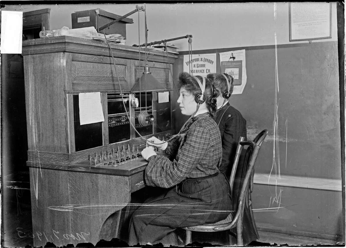 Image of two Chicago Daily News telephone operators sitting at a switchboard, Chicago, Illinois, November 7, 1903. From the Chicago Daily News collection. (Photo by Chicago History Museum/Getty Images)