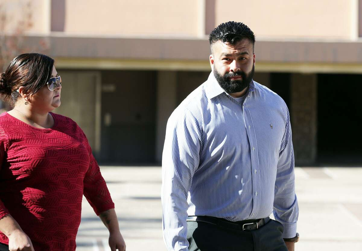 Former Army recruiter Julian Prezas walks outside the John H. Wood Federal Courthouse in San Antonio on Monday. He admitted to funneling dozens of assault rifles to an operative of Mexico's Gulf Cartel, weapons that he bought with the help of fellow soldiers.