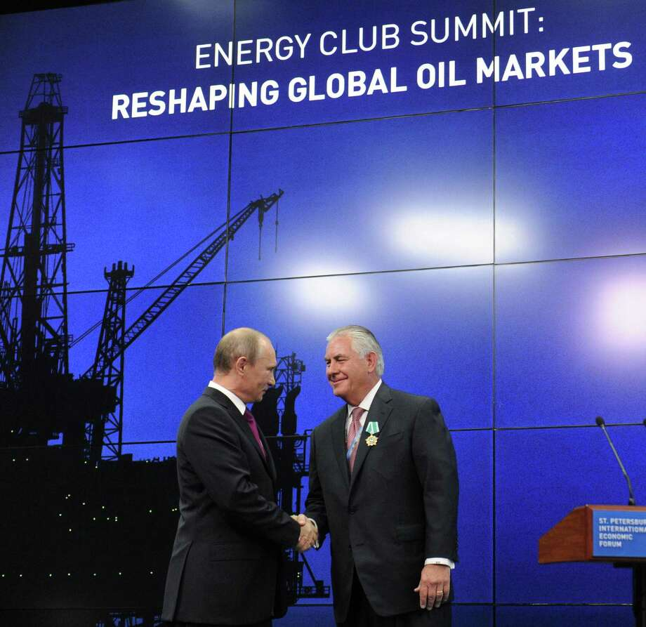 Russian President Vladimir Putin with ExxonMobil CEO Rex Tillerson. Under Tillerson's watch, ExxonMobil posed a strong competitive challenge to Russian oil companies. From that position of strength, the company did well in negotiations with the Russian government. Photo: AFP /Getty Images /File Photo / AFP