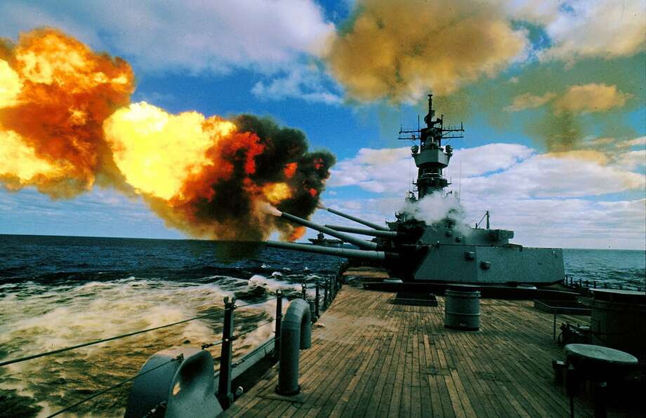 In this Dec. 16, 1987 file photo, the battleship USS Iowa fires its 16-inch guns during duty in the Persian Gulf. The 887-foot long ship that once carried President Franklin Roosevelt to a World War II summit to meet with Churchill and Stalin is coming to life once again for what is most likely her final voyage this month to become a floating museum in Los Angeles. (AP Photo/Eric Risberg, File) Photo: ERIC RISBERG, STF / AP / AP1987