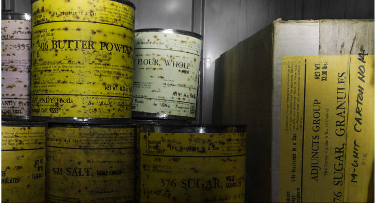 Canned During the Cold War, people stocked bomb shelters with supplies such as butter, sugar, powdered milk and other items that would last over time. These cans and boxes were found in an abandoned bomb shelter in Florida.