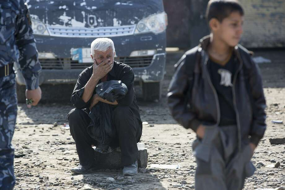 Residents like this man are fleeing Mosul and recounting the 2½ years of brutality under the Islamic State. Photo: Nish Nalbandian, Associated Press
