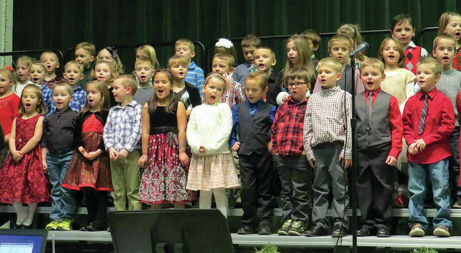 "The Laker Elementary kindergartners charm the crowd with ""I'm a Little Snowflake,"" during a recent Christmas program. Photo: Laker Elementary"
