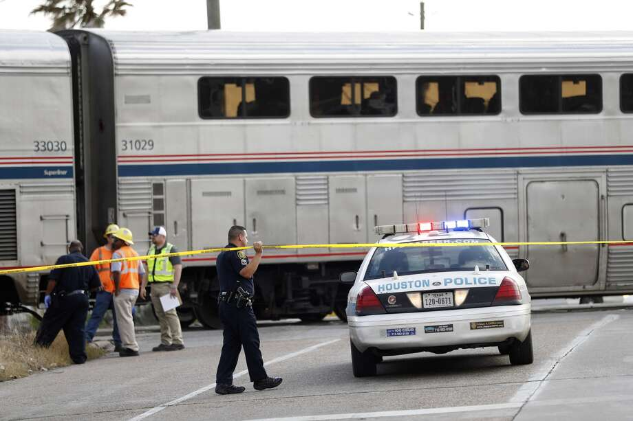 Police investigate the scene of a pedestrian struck and killed by an Amtrak passenger train shortly after noon Tuesday, Dec. 13. 2016. (Karen Warren / Houston Chronicle)
