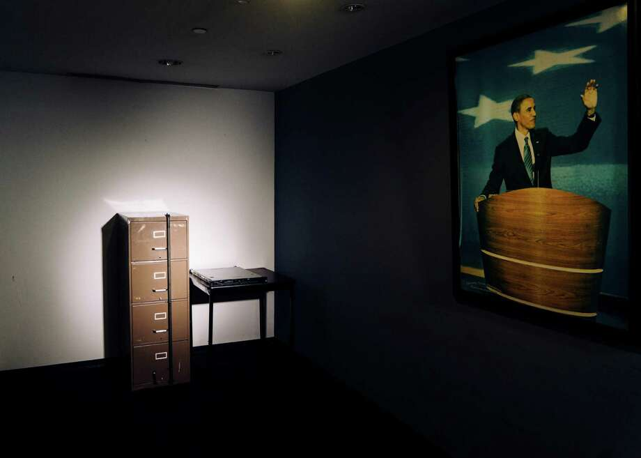 A filing cabinet broken into in 1972 as part of the Watergate burglary, beside a computer server that Russian hackers breached during the 2016 presidential campaign, both now in the basement of the Democratic National Committee's headquarters in Washington, Dec. 12, 2016. An investigation into the Russian operation reveals a series of missed signals, slow responses and a continuing underestimation of its seriousness. (Justin T. Gellerson/The New York Times) Photo: JUSTIN T. GELLERSON, NYT / NYTNS