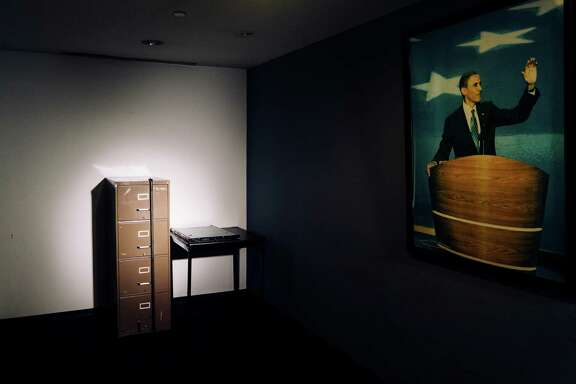 A filing cabinet broken into in 1972 as part of the Watergate burglary, beside a computer server that Russian hackers breached during the 2016 presidential campaign, both now in the basement of the Democratic National Committee's headquarters in Washington, Dec. 12, 2016. An investigation into the Russian operation reveals a series of missed signals, slow responses and a continuing underestimation of its seriousness. (Justin T. Gellerson/The New York Times)