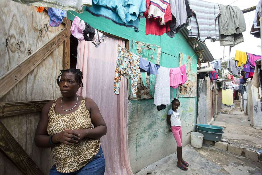 Adrienne St. Fume stands outside her shelter in the Delmas tent camp set up set up nearly seven years ago for people displaced by the 2010 earthquake, in Port-au-Prince, Haiti. Photo: Dieu Nalio Chery, Associated Press